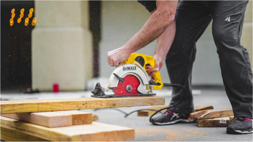 Man cutting wood with a power saw