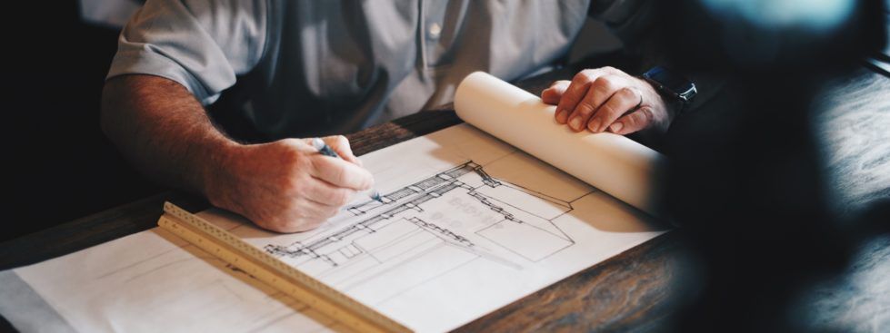 Image of a man drawing architectural plans