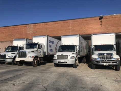 four delivery trucks lined up