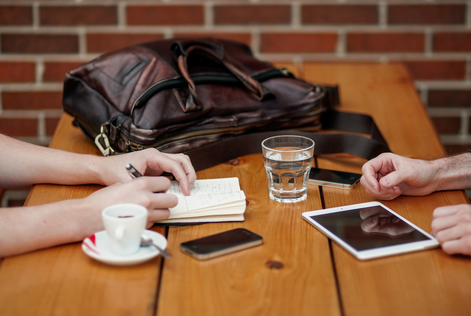 Close up image of a business meeting with coffee, notes and iPads