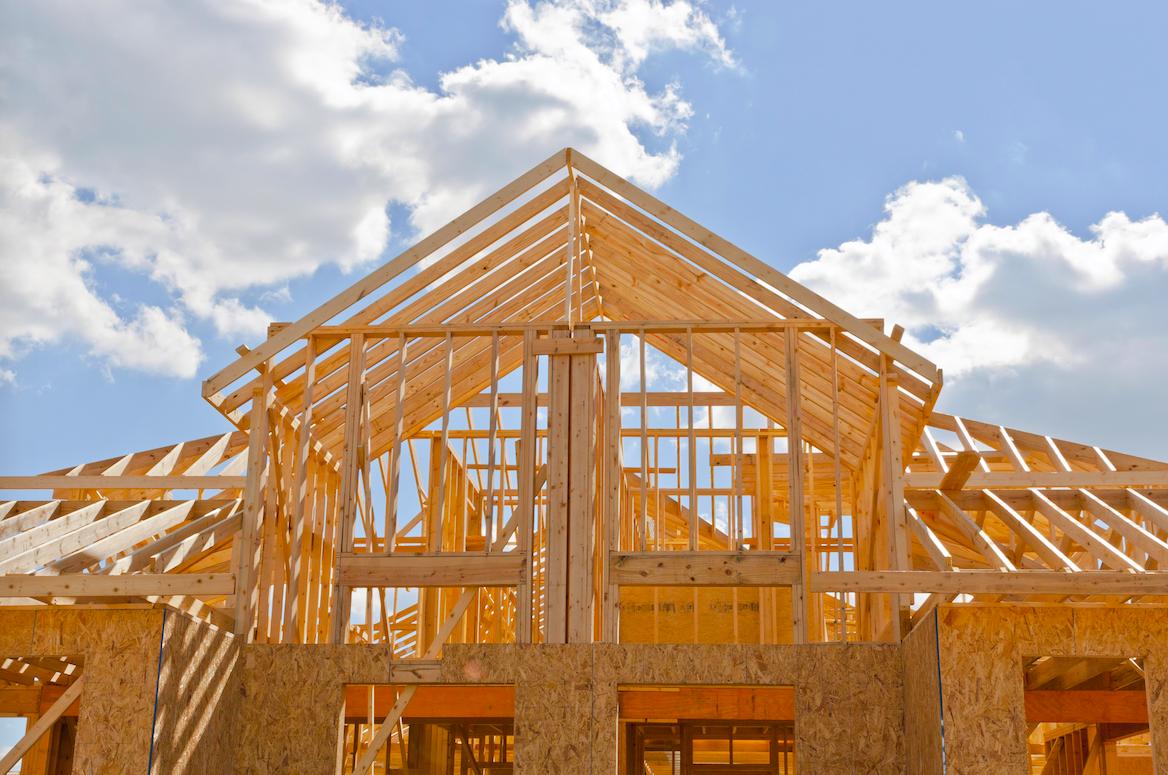 Light tan housing frame with a beautiful blue sky.