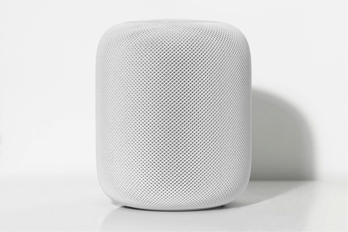 Smart home app gadget that is white with a speaker.